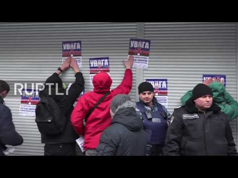 Ukraine: Protesters deface Russian-owned banks in Kiev