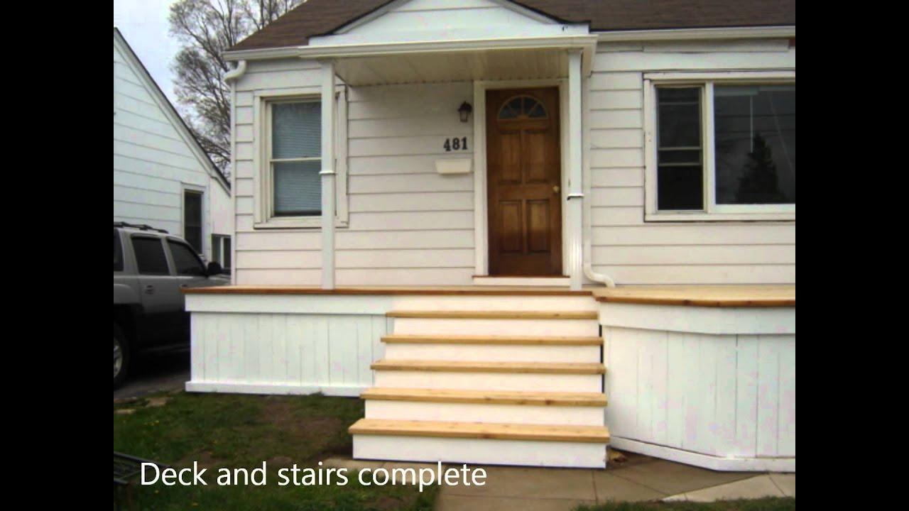 A cedar white front porch deck