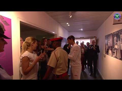 Victorious Novak Djokovic greets fans and famous faces