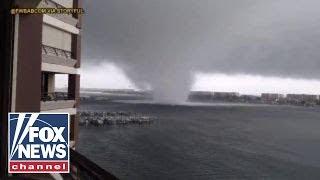 Dramatic video: Waterspouts rip through Florida beach