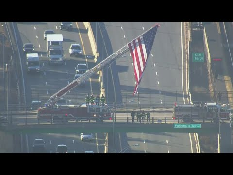 Web Extra: Fire Truck With American Flag Pays Tribute To Fallen Firefighter
