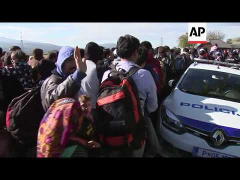 Migrants waiting in field near Slovenia border