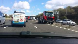 2 Lorries Crash Through Central Reservation on M62