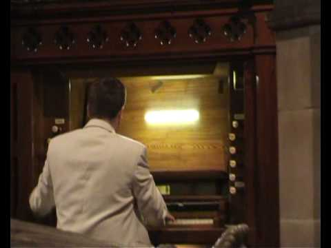 Christian Cartwright on the organ at Fenny Bentley
