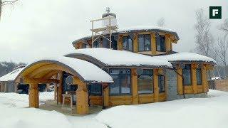 Разноуровневый дом с эркерами по технологии бревенчатого каркаса