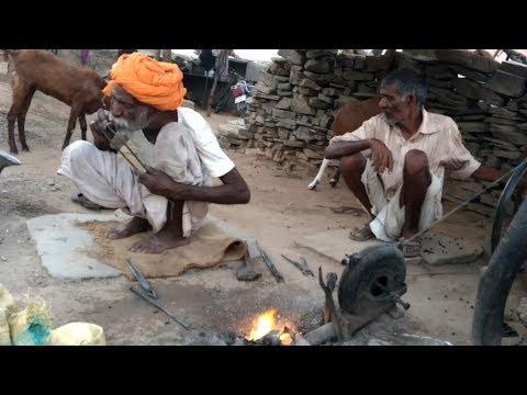 Indian Blacksmith man work very hard   The blacksmith making farming tools