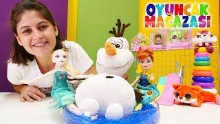 Karlar Ülkesi Elsa ve Anna oyuncak mağazamızda! Oyun videosu.