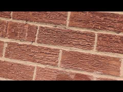 Cleaning off excess mortar on the brick facade with concentrated Hydrochloric acid