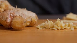 Pan shot of finely chopped and fresh ginger root kept on the table