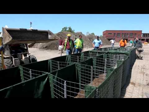 Demonstrating HESCO flood-control barriers in Cedar Rapids