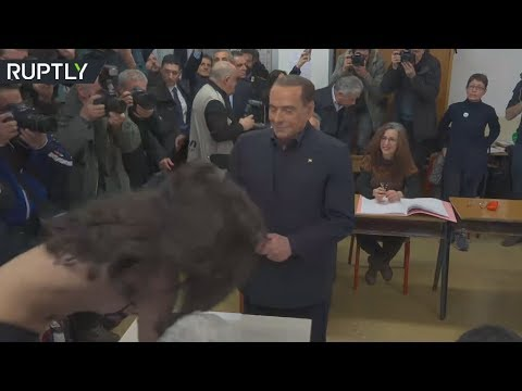 Topless FEMEN activist confronts Berlusconi as he votes