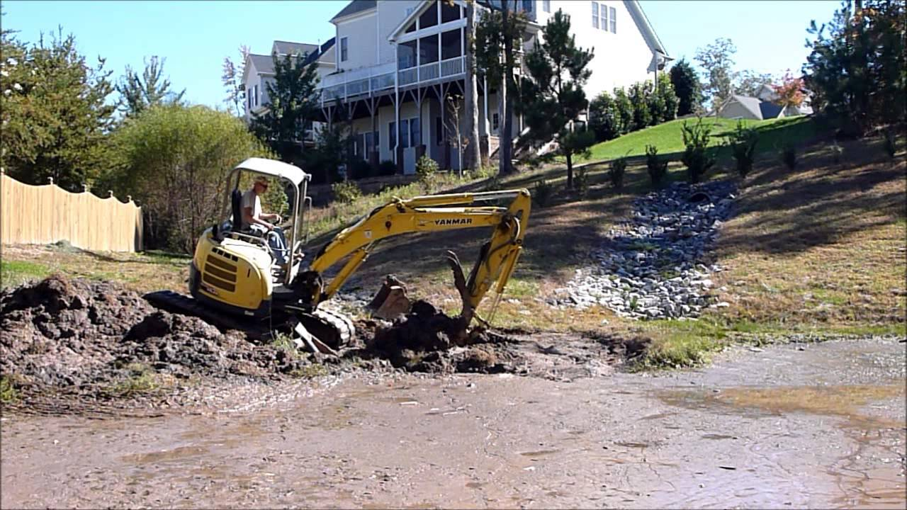 Mini Excavator Digging Mud