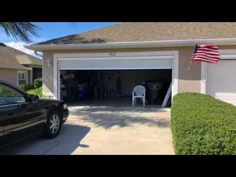 Motorized privacy solar garage screen