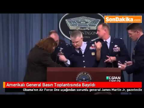 Major general faints during news conference