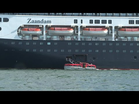 AFP News Agency: Coronavirus: Stranded cruise passengers transfer to another vessel in Panama | AFP