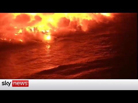 Life on La Palma continues as lava hits sea