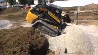 New Holland C238 Compact Track Loader Pushing Stone