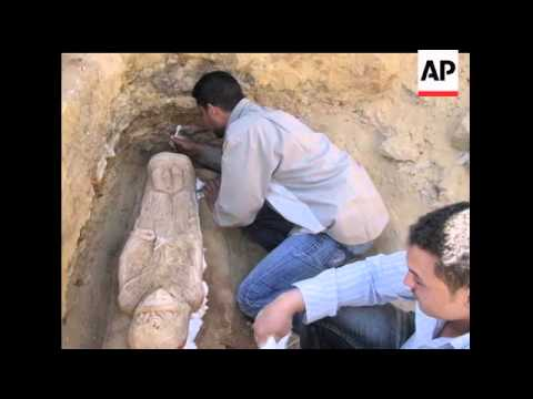 Egyptian archaeologists discovered an intricately carved plaster sarcophagus portraying a wide-eyed
