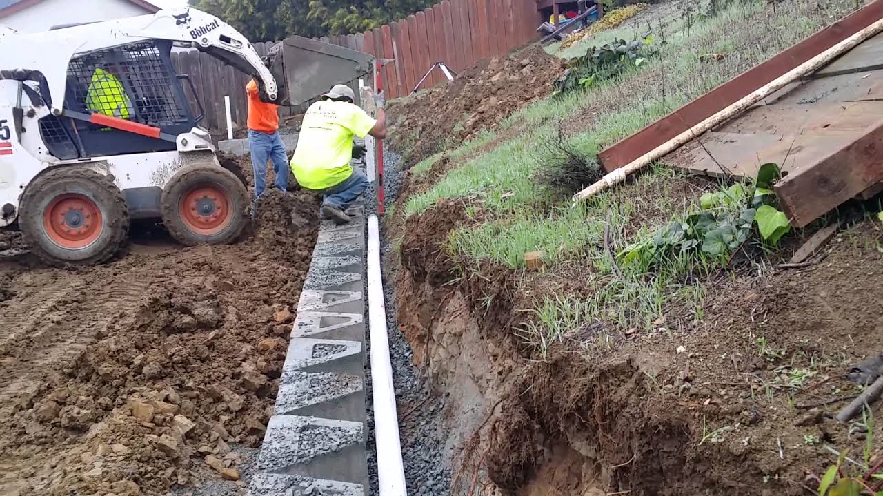 Adding Drainage Pipe & Drain Rock To Retaining Wall - YouTube