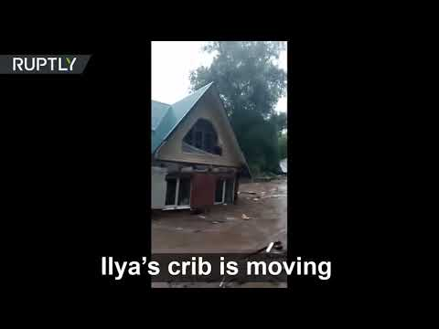 'Ilya's house is on the move!'  | A dam broke in the city of Ruza, leaving buildings FLOATING around