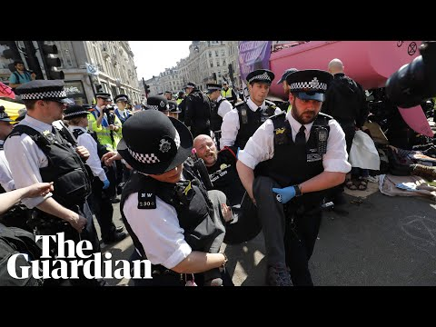 Police arrest climate change protesters on London's Oxford Circus