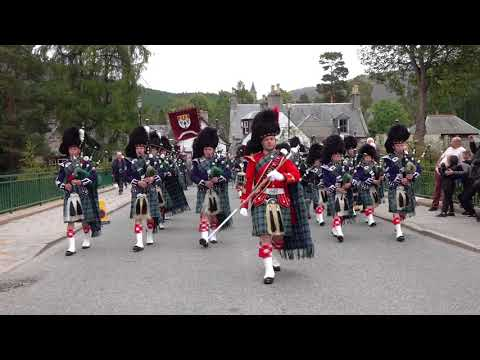2018 Braemar Gathering parade of Royal Highland Society led by Ballater Pipe Band to Games