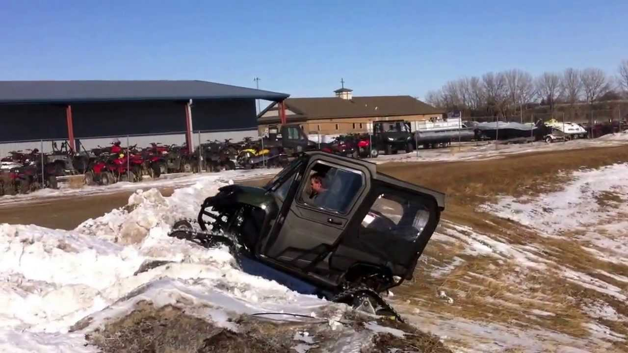 Check out this 2014 Honda Pioneer SXS700M4 with tracks and heated cab! - YouTube