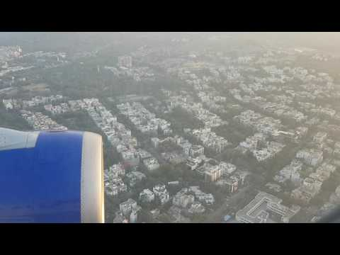 Landing in New Delhi. Lotus temple and aerial view of Delhi city