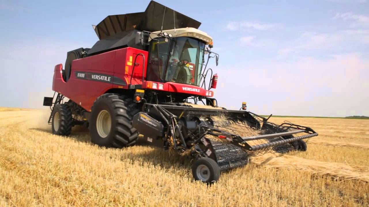 Versatile RT490 Combine harvesting barley - YouTube