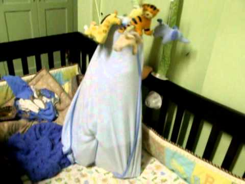 Baby Paul Raymond Stands on Crib as Super Baby.