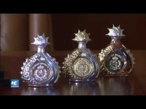 Botella Mini mas Cara del Mundo Cognac Henri IV Dudognon