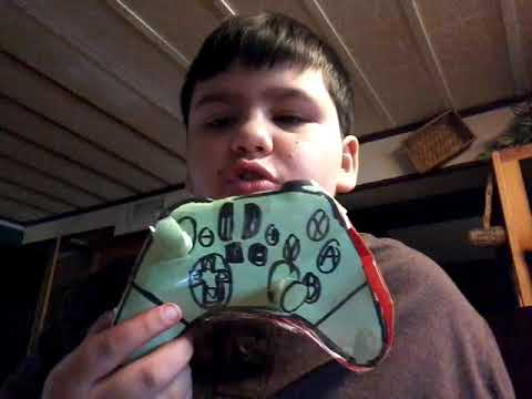 Adin shows all of his paper Nintendo switch