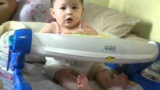 5month old baby playing piano while singing
