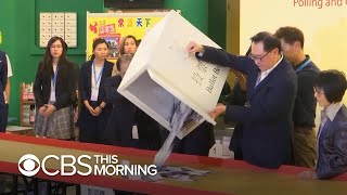 Hong Kong's pro-democracy movement sees landslide victory in local elections