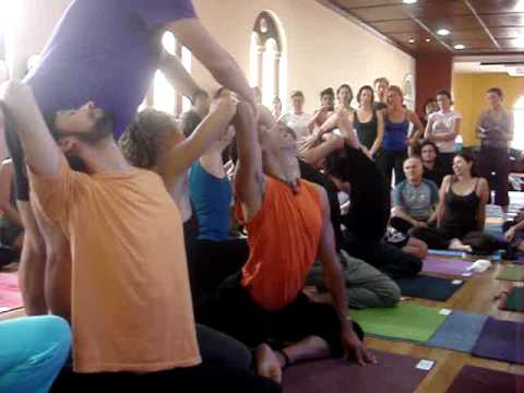 John Friend - Men demonstrate Pigeon Pose - Anusara Yoga Bogota, Colombia