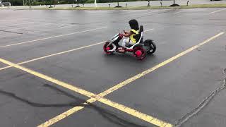 Toddler driving racing car