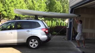 Loading Hobie Revolution kayak onto the roof rack