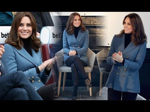 Kate Middleton COVERS growing baby bump in long blue jacket at West Ham's London Stadium