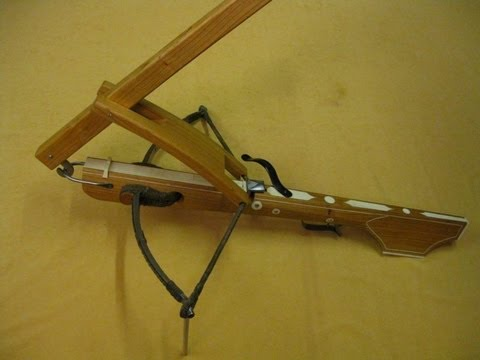 A Crossbow being strung - Armbrust spannen mit der Wippe 十字弓 - YouTube