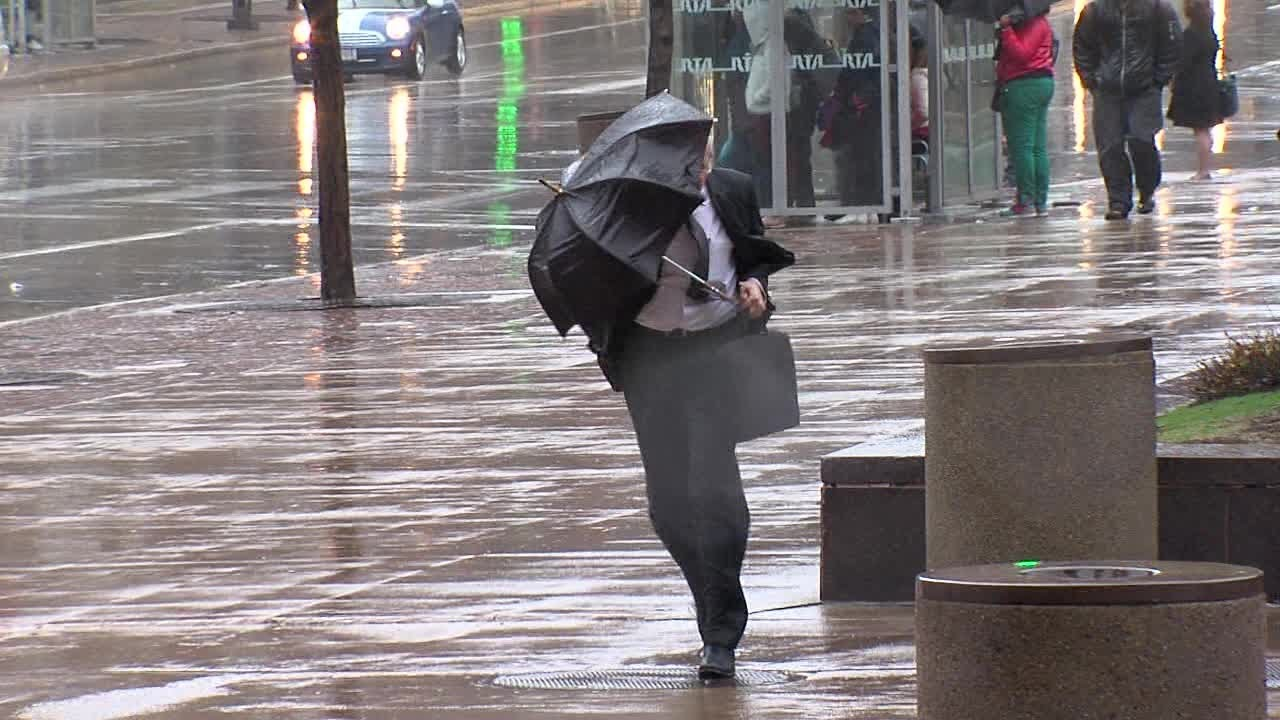 windy weather and umbrellas in cleveland [ 1280 x 720 Pixel ]