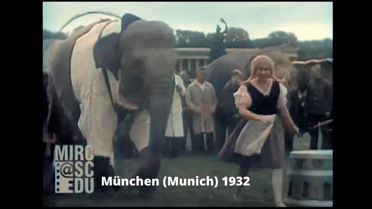 Download 1932: Elephant and Girl dancing at Theresienwiese, Munich, Germany [DeOldified]