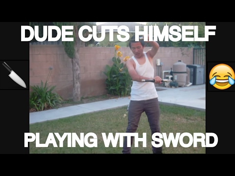DUDE CUTS HIMSELF PLAYING WITH SWORD (MUST WATCH)