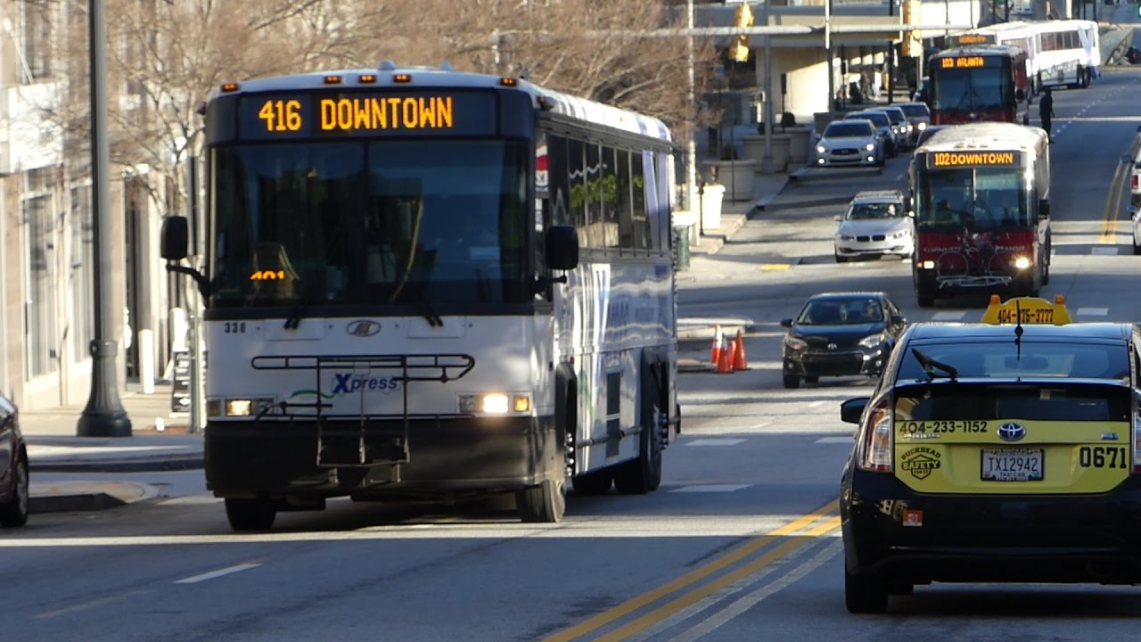 GRTA/GCT: 2004/09 MCI D4500CL Routes 416 102 & 103 Buses #338 #7001 #7005  at W Peachtree St