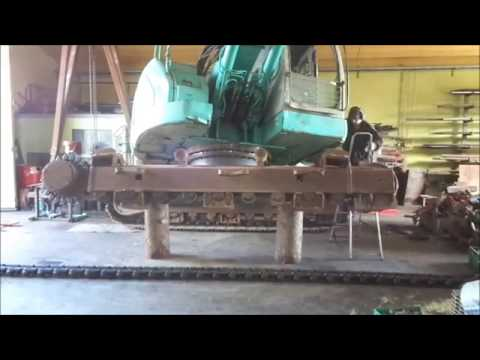 Undercarriage service with new Vematrack chains for Kobelco SK235 excavator