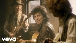 The Traveling Wilburys - End Of The Line (Official Video)