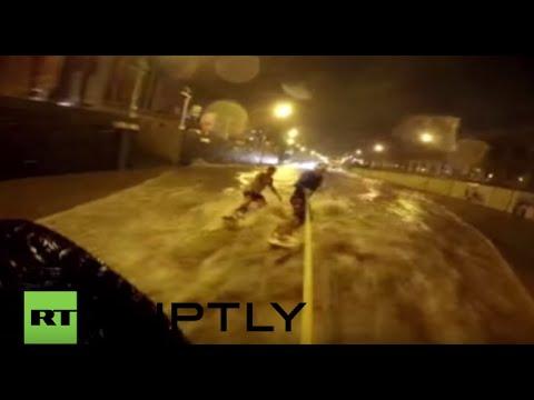Russia: Daredevils SURF on flooded Vladivostok roads