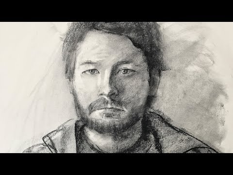 Portrait drawing of a student from live using charcoal