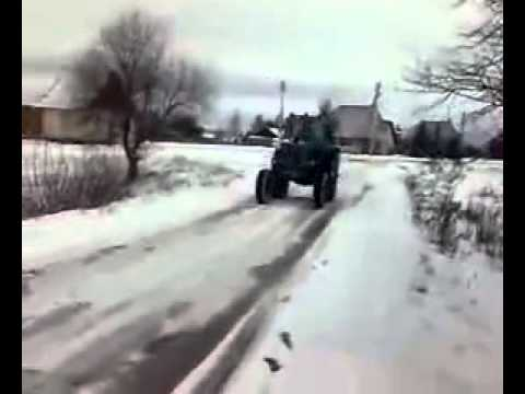 Russian farmer slides with his tractor and fails