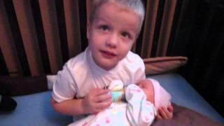 Big Brother feeding Little Sister