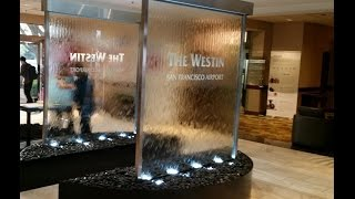 Custom Glass Waterfall Walls at Westin Hotel at San Francicso Airport-Water Walls with Etched Logo